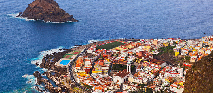 Rocky Tenerife coastline, red roofed houses, from above