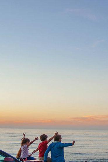 Sitting on a car, watching a Torremolinos sunset
