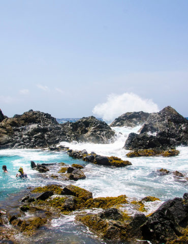 People in a natural pool in Tenerife